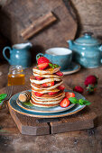 Pancakes with strawberries and honey