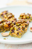 Pistachio bars (shortbread pastry with pistachio flour and caramelised honey pistachio nuts)