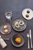 Parmesan tart with tomatillo, oyster with finger lime and scampi roes, cucamelon with pistachio butter and kingfish with Cape
