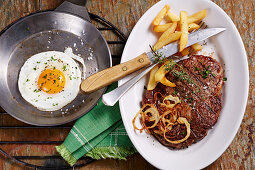Bistec a lo Pobre (beef steak with chips, onions and fried egg, Chile)