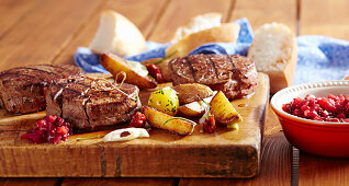 Grilled beef fillet steak with lingonberry chutney and potato wedges