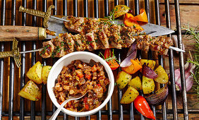 Grilled Andalusian lamb skewers with a vegetable relish and grilled vegetables