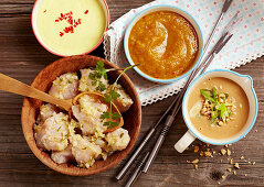 Ingredients for chicken fondue with various sauces