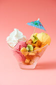 1980s fruit ice cream cup with strawberry and mango ice cream and whipped cream