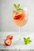 Summer white sangria with strawberries and peaches