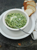 Wild garlic risotto in a porcelain bowl