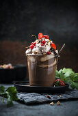 Hazelnut chocolate drink with nougat cream and red fruits – vegan