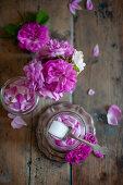Pink roses and sugar in screw-top jar