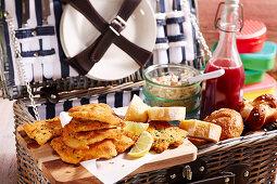 Breaded chicken escalopes and avocado remoulade in a picnic basket