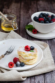 Japanese souffle pancakes with fruits and honey