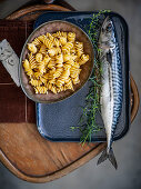 An arrangement of pasta, rosemary and fish