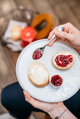 Scones with clotted cream and berry jam