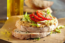 Bread with homemade hummus, lettuce strips and tomatoes