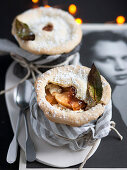 Apple and ricotta pies with bay leaves