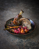 Saffron and orange-braised lamb shoulder with braised baby carrot and roasted beetroot