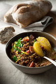 Braised Castelluccio lentils with oranges, onions and bacon
