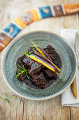 Kangaroo goulash with Tasmanian mountain pepper and purple carrots