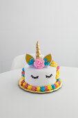 Colourful decorated unicorn cake