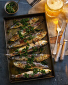 Whole Cooked Sardines With Lemon, Herbs and Beer