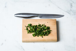Save a colourless sauce by adding chopped herbs to it
