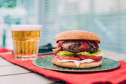 Delicious homemade cheeseburger with lettuce, tomato and sauces