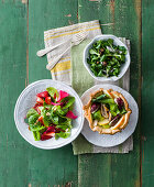 Salads with strawberry and olive dressing, and a salad with chicken and pear