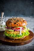 Vegan burger made with chickpeas pattie, vegetables and lemony coconut cream dressing.