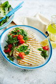 Grilled swordfish with braised cherry tomatoes and fresh herbs