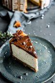 A piece of Christmas chocolate cheesecake decorated with anise stars