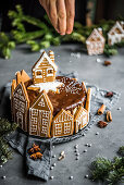Christmas chocolate cheesecake decorated with gingerbread cottages