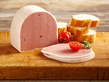 Sliced liver pâté on a wooden board