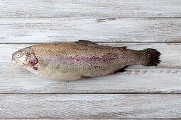 A trout on a wooden surface