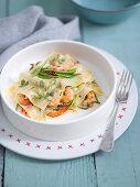 Shrimp lasagna with herb noodle plates and julienne cut zoodles
