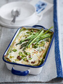 Green lasagne with ricotta, salsiccia, green asparagus and borage