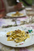 Artichoke ravioli with caramelized onions and olives