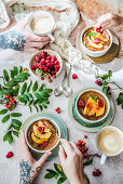 Baked oat pudding with caramel cream, nectarines and raspberries, served with coffee