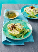 Oregano omelette rolls with goat's cheese, anchovies and aubergine strips