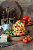 Cheese waffles with tomatoes