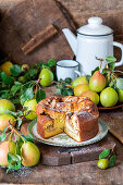 Pear sponge cake with almond flakes