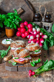 Bagels with cream cheese and vegetables