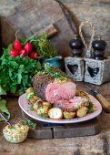 Roasted beef with potatoes and mustard butter