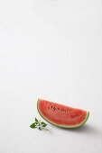 Watermelon slice and jasmine flowers on a white background