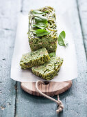 Bucatini terrine with herb pesto and rabbit ragout