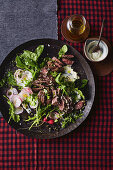 Seared kangaroo loin salad with horseradish and rocket