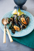 Mussels with a spicy rice filling