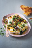 Olive and caper baked halloumi