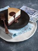 Cheesecake with dark chocolate sauce