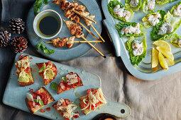 Sesame chicken skewers, bruschetta and prawn lettuce cups