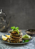Spicy maakouda (potato fritter) stack with avocado mayonnaise