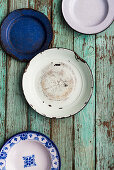 Enamel plates on a turquoise surface